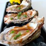 Wood Grilled Oysters with a Smoky BBQ Sauce