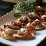 Fresh Burrata and Heirloom Tomato Salad with Basil Cream on Crostini